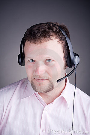 Smiling male customer service operator in headset