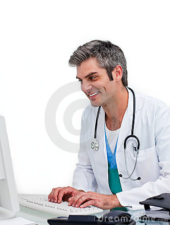 Smiling male doctor working at a computer