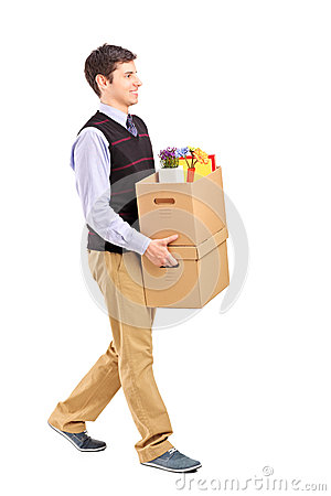 Smiling male walking with boxes