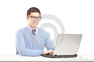 Smiling male working on a laptop