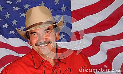 Smiling man against US flag