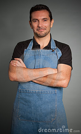 Smiling man with apron