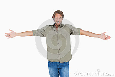 Smiling man with arms open wide