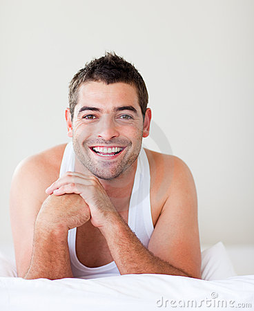 Smiling man in bed