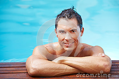 Smiling man at edge of pool
