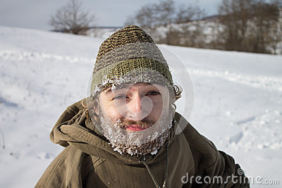 A smiling man with frozen beard