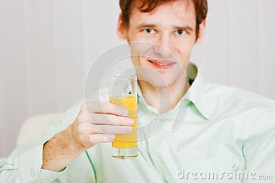 Smiling man with a glass juice