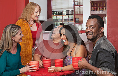Smiling Man with Group of Friends