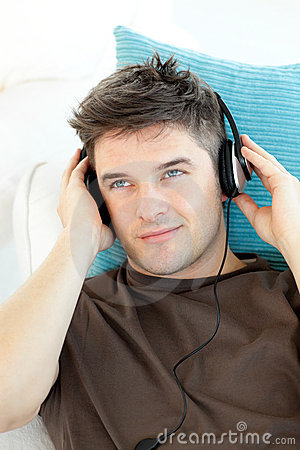 Smiling man with headphones listening to music