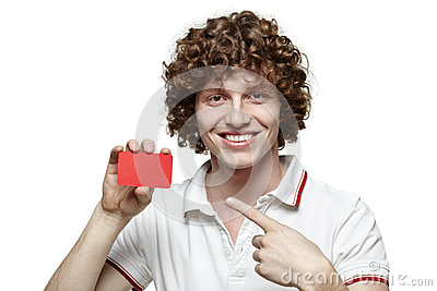 Smiling man holding blank credit card