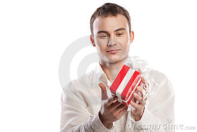 Smiling man holding gift isolated on white