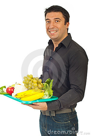 Smiling man holding healthy nutrition