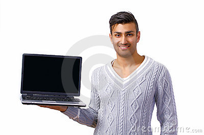 Smiling man holding laptop