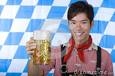 Smiling man holding Oktoberfest beer stein (Mass)
