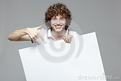 Smiling man holding whiteboard