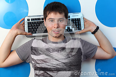 Smiling man holds on nape keyboard