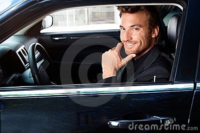 Smiling man in limousine