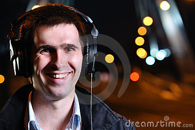 Smiling man is listening music