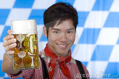 Smiling man with Oktoberfest beer stein (Mass)