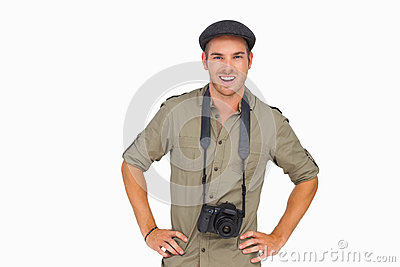 Smiling man in peaked cap with camera around his neck