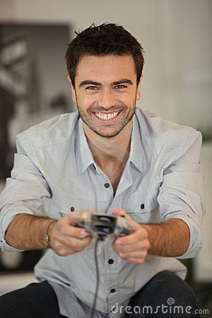 Smiling man playing games
