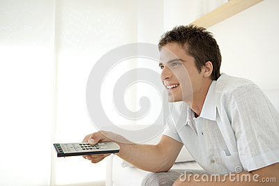 Smiling Man with Remote Control