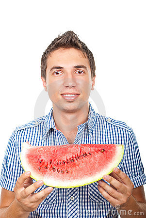 Smiling man showing watermelon