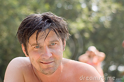 Smiling man after swimming