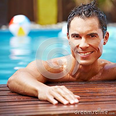 Smiling man in swimming pool