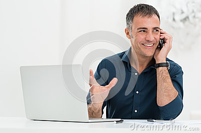 Smiling Man Talking On Cellphone
