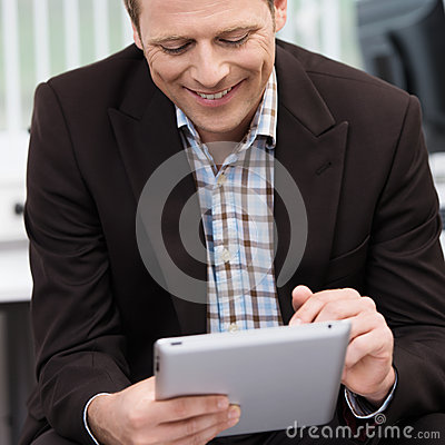 Smiling man using a tablet-pc