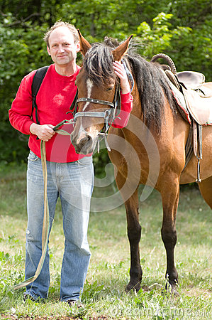 Free Smiling Man With Horse In The Forest Royalty Free Stock Photography - 25569197
