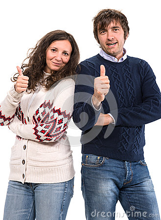 Smiling man and woman showing thumbs up sign