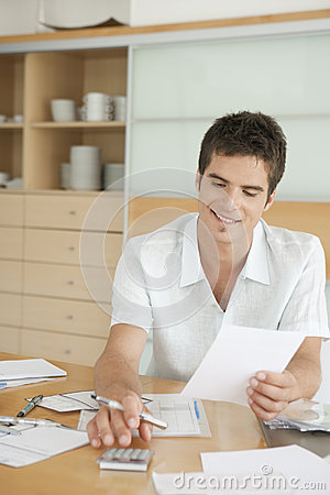 Smiling Man Working on Finances