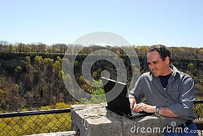 Smiling man working outdoors