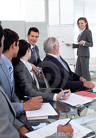 Smiling manager giving a presentation to her team