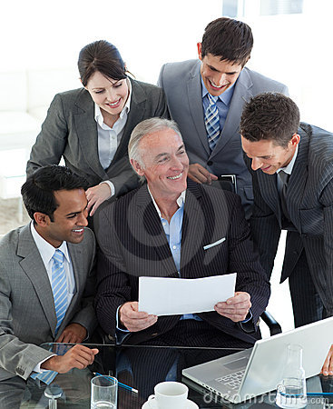 Smiling manager pointing at a contract