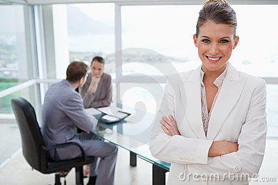 Smiling manager standing in conference room