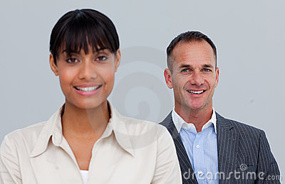 Smiling mature businessman behind his colleague