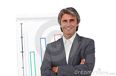Smiling mature businessman in front of a board