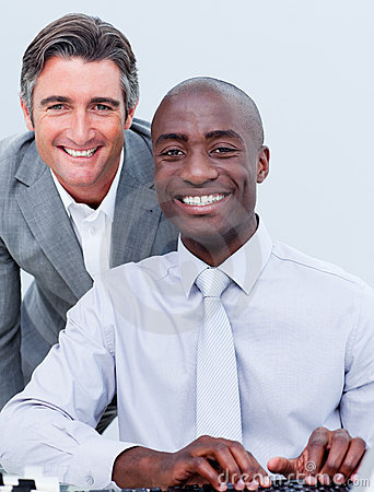 Smiling mature businessman helping his colleague