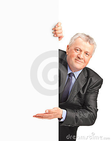 Smiling mature businessman holding a white panel