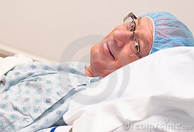 Smiling, mature caucasian man ready for surgery.