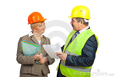 Smiling mature engineers having conversation