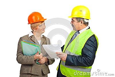 Smiling mature engineers having conversation