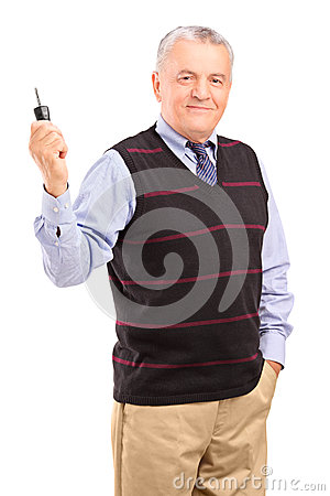 Smiling mature gentleman holding a car key