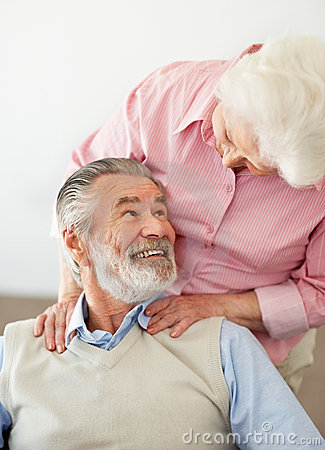 Smiling mature man looking at a loving senior woma