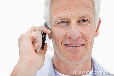 Smiling mature man making a phone call