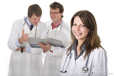 Smiling medical doctor with her colleagues