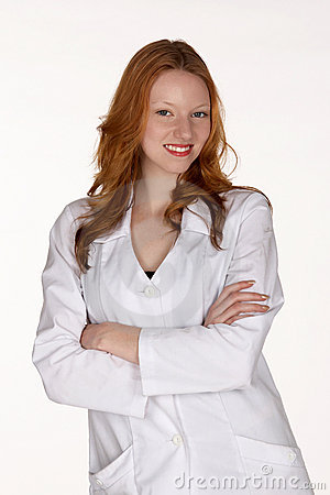 Smiling Medical Professional in Lab Coat with Arms Folded